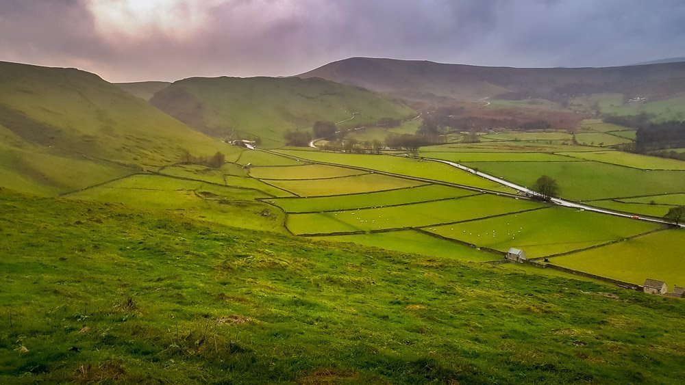 Winnats-Pass-to-the-left-and-across-valley-Mam-Tor Cave Dale Walk, Rugged and Scenic – Castleton, Peak District