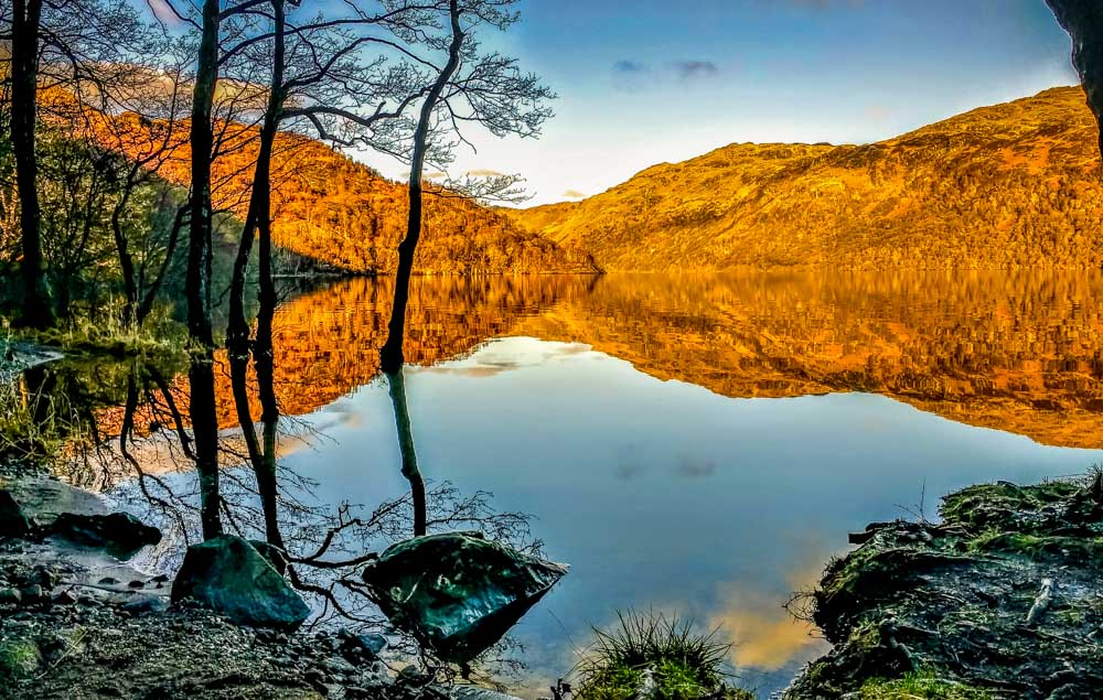 loch-lomond-reflective-with-rocks A Scotland Escape To Crianlarich and Beyond