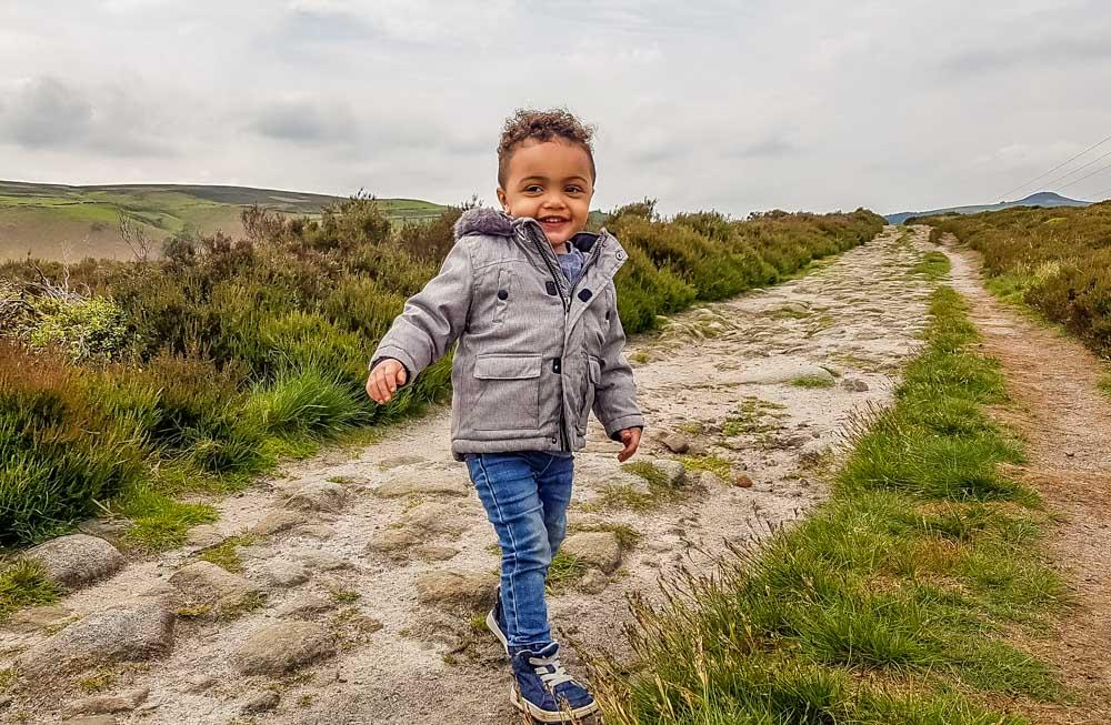 Elijah-walking-in-Derbyshire Walking to the Wheel Stones on Derwent Edge – Peak District