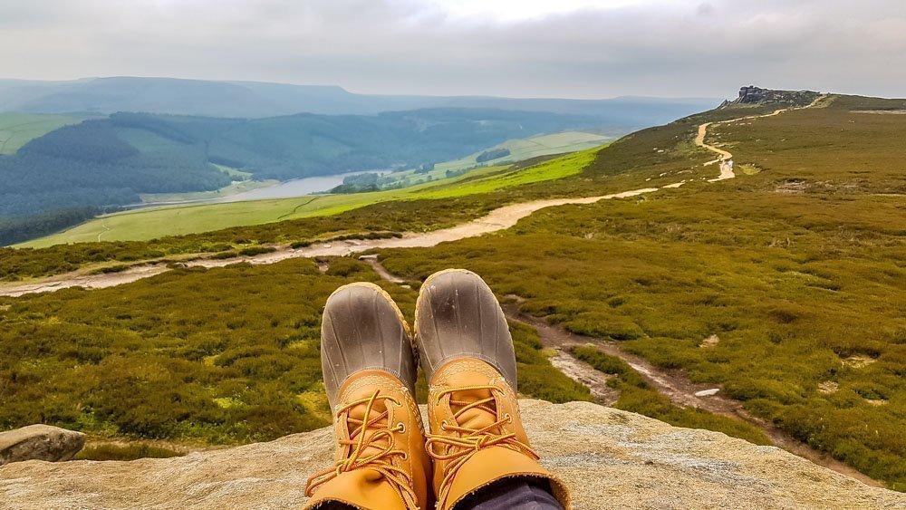 Sitting-on-the-Wheel-Stones Walking to the Wheel Stones on Derwent Edge – Peak District