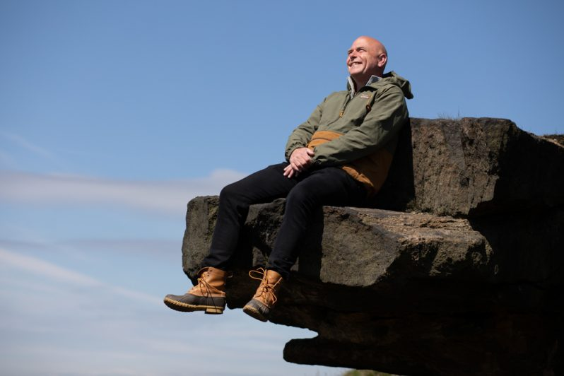 sat on rock in beanboots