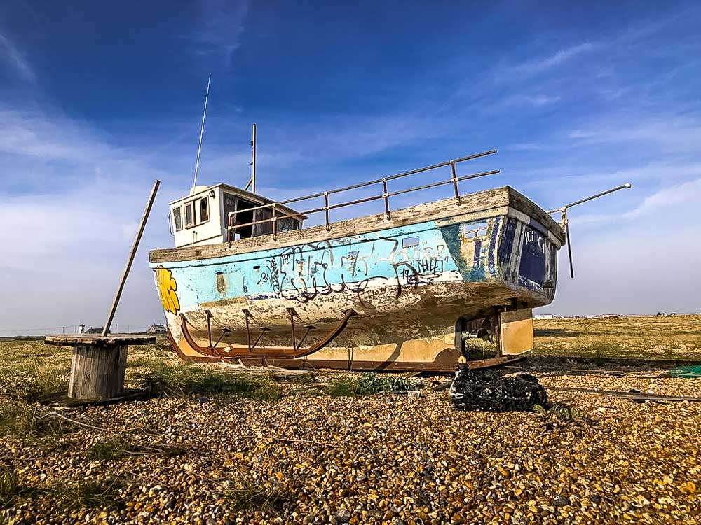 quirky boat wreck with graffiti