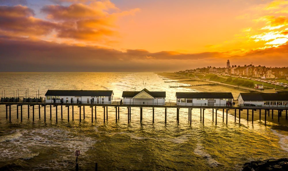 southwold pier and the town at sunset