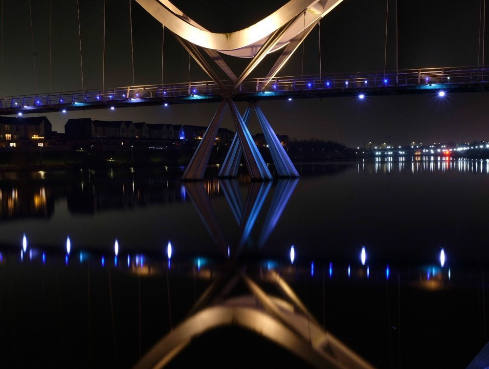 reflection of infinity bridge in the water