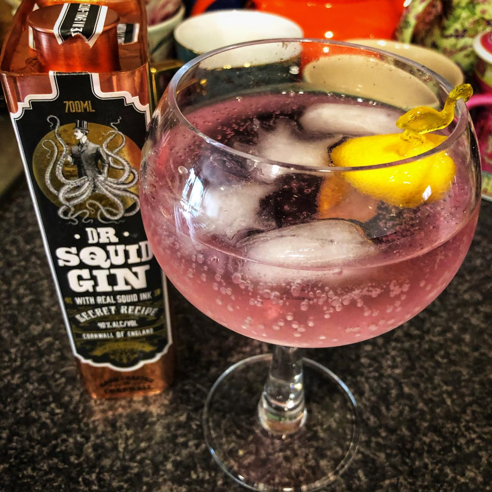 pours black but turns pink with tonic