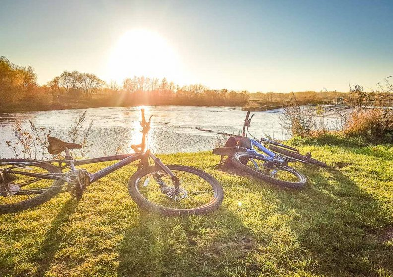 Healthy cycling, two bikes beside the river