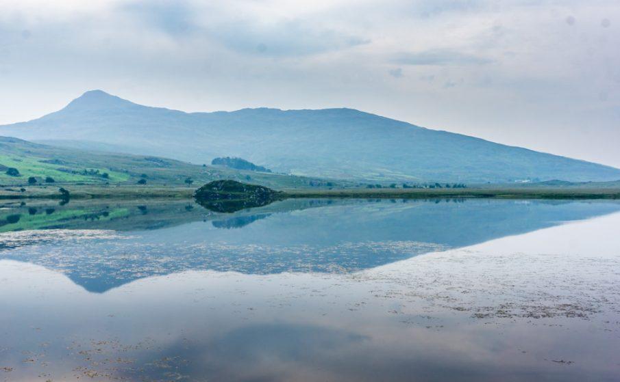 Yr Aran reflecting in Llyn y Gader