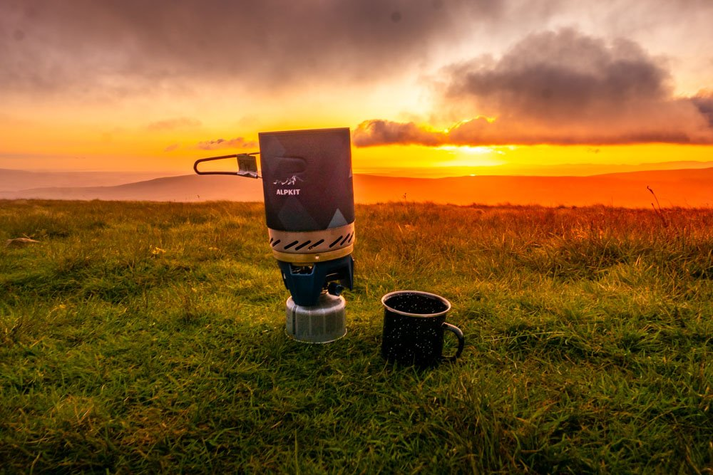 sunset and camping stove