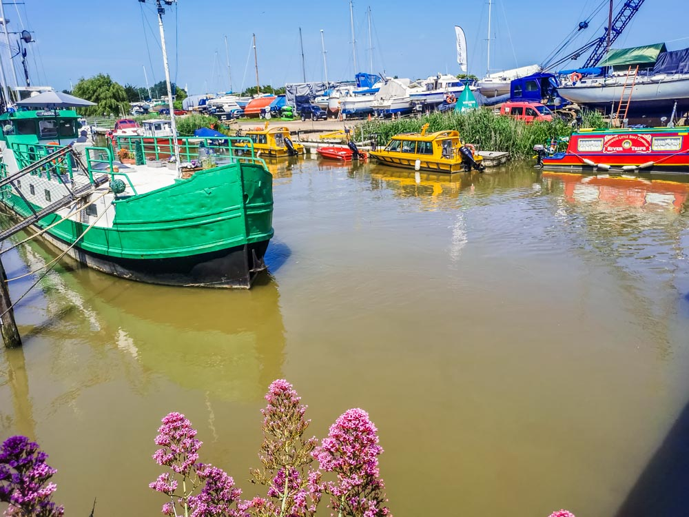 Boats on the River Stour Sandwich at boat yard in background