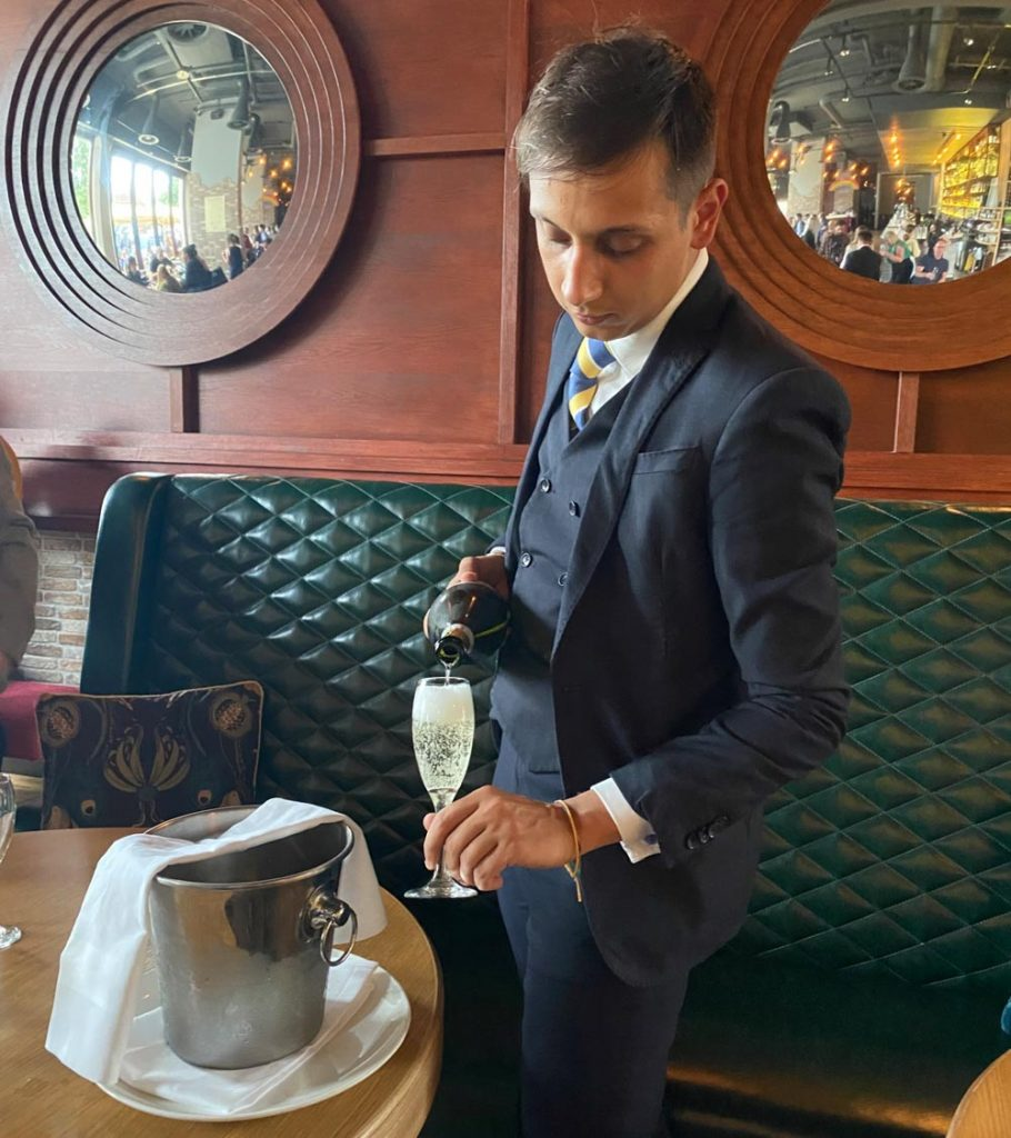 waiter pouring the fizz