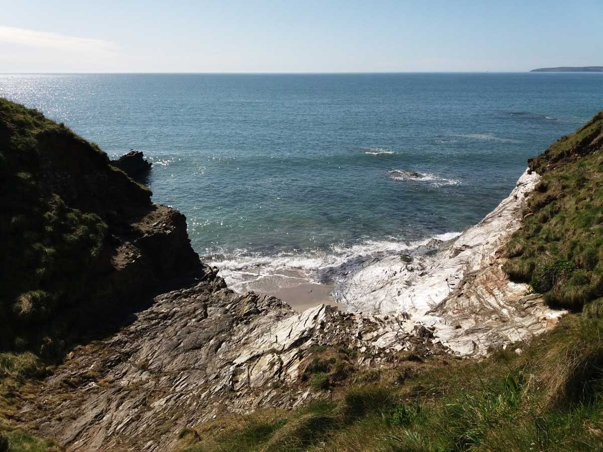 An-empty-beach-cove Cornish Coastal Walk - Carlyon Bay to Par via Cliffs, Beaches & Coves