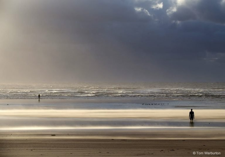 The figures of Another Place on Crosby Beach