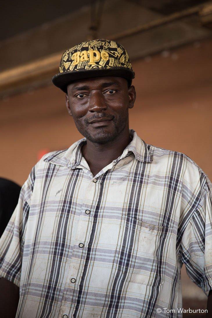 Gambian in baseball cap