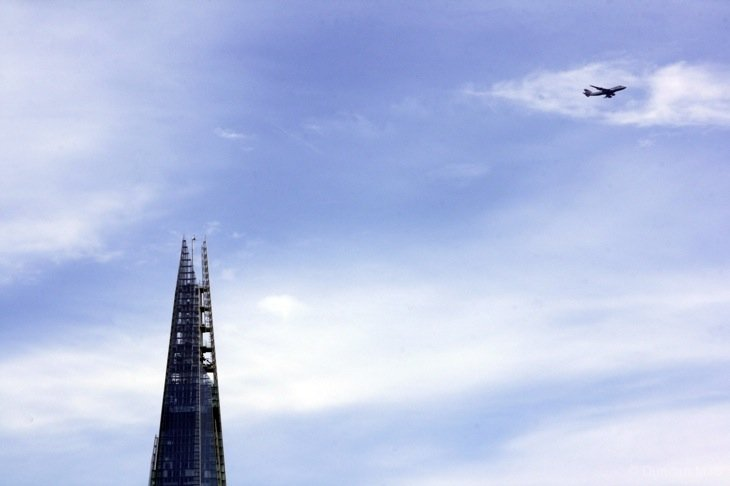 Plane flying past the top of the Shard