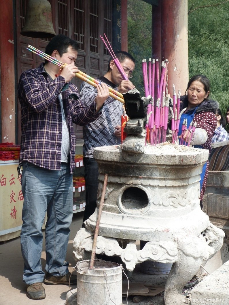 Incense-sticks-being-lit-outside-the-temple-china A hike up and across Qingcheng Mountain of China