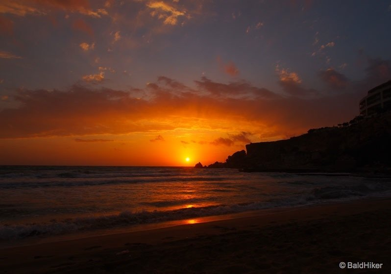 A Malta sunset from Golden Bay Beach