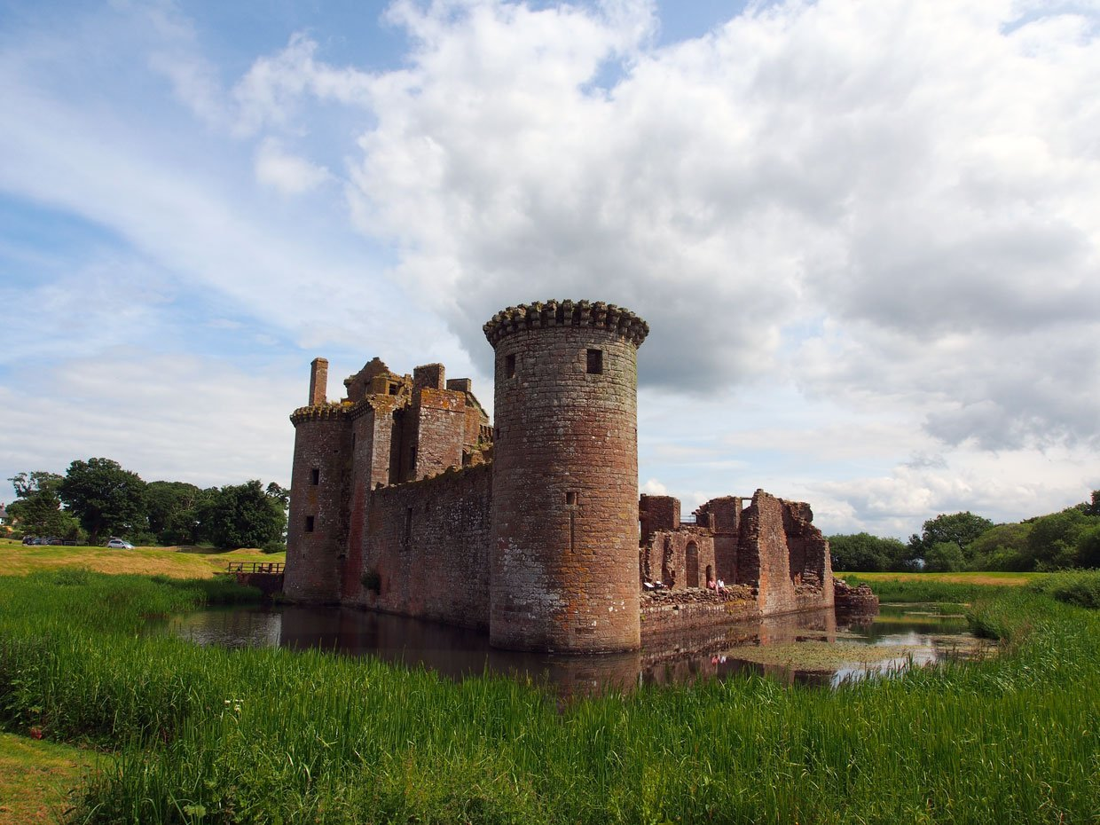 Caerlaverock Castle and moat with reeds