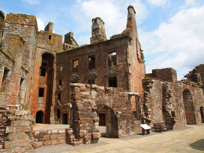ruins of Caerlaverock Castle with detail inside
