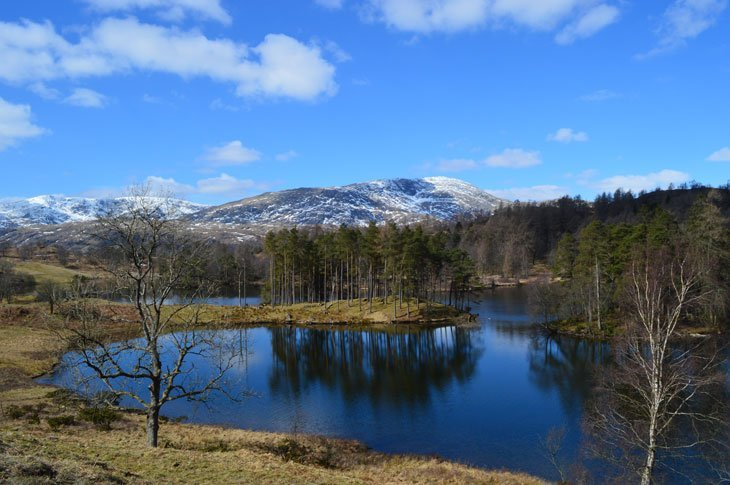 Tarn Hows with winter mountains