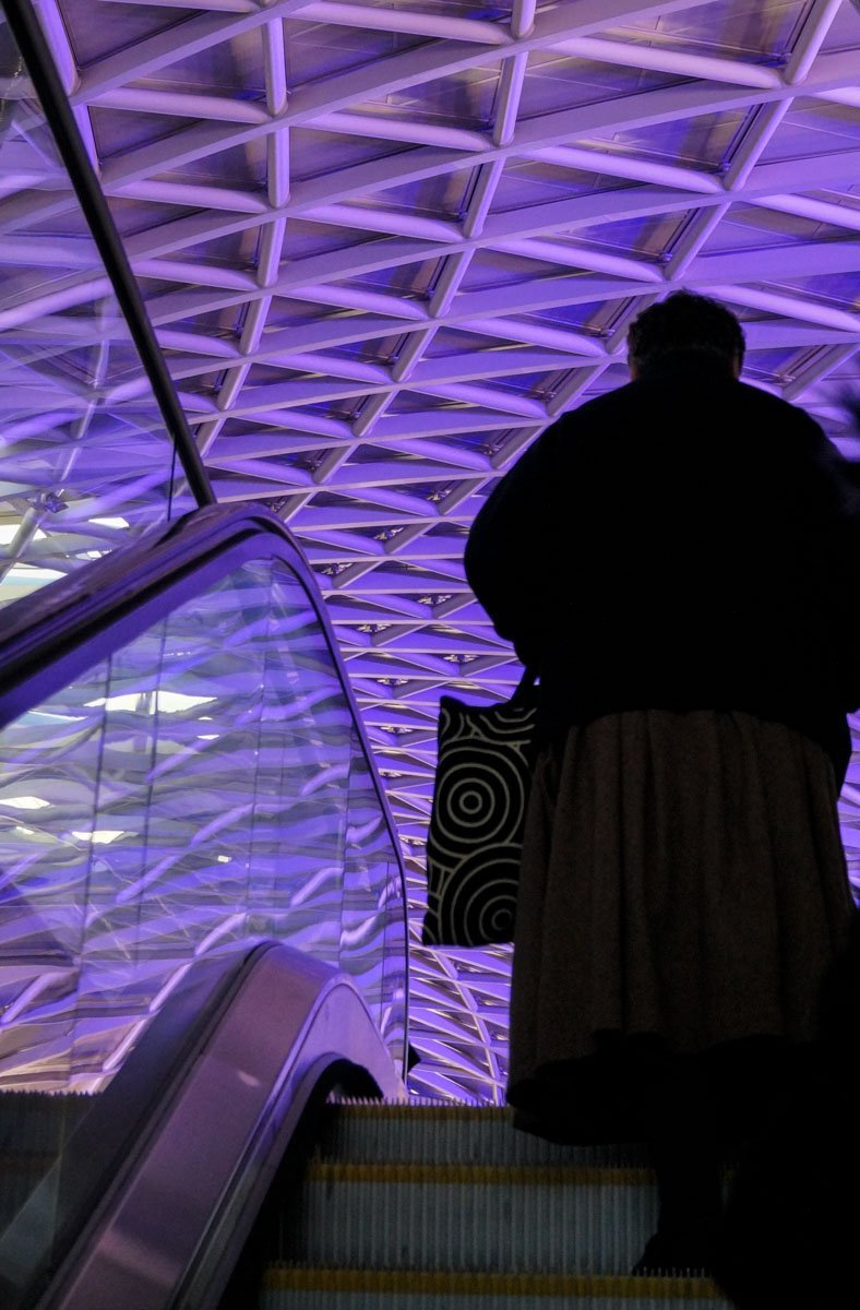 Woman-on-escalator King's Cross Station – Entry to the Hogwarts Express
