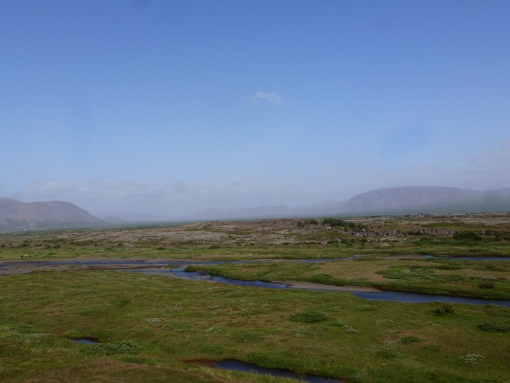 Iceland - Waterfalls, Water Spouts and Views from a Rift