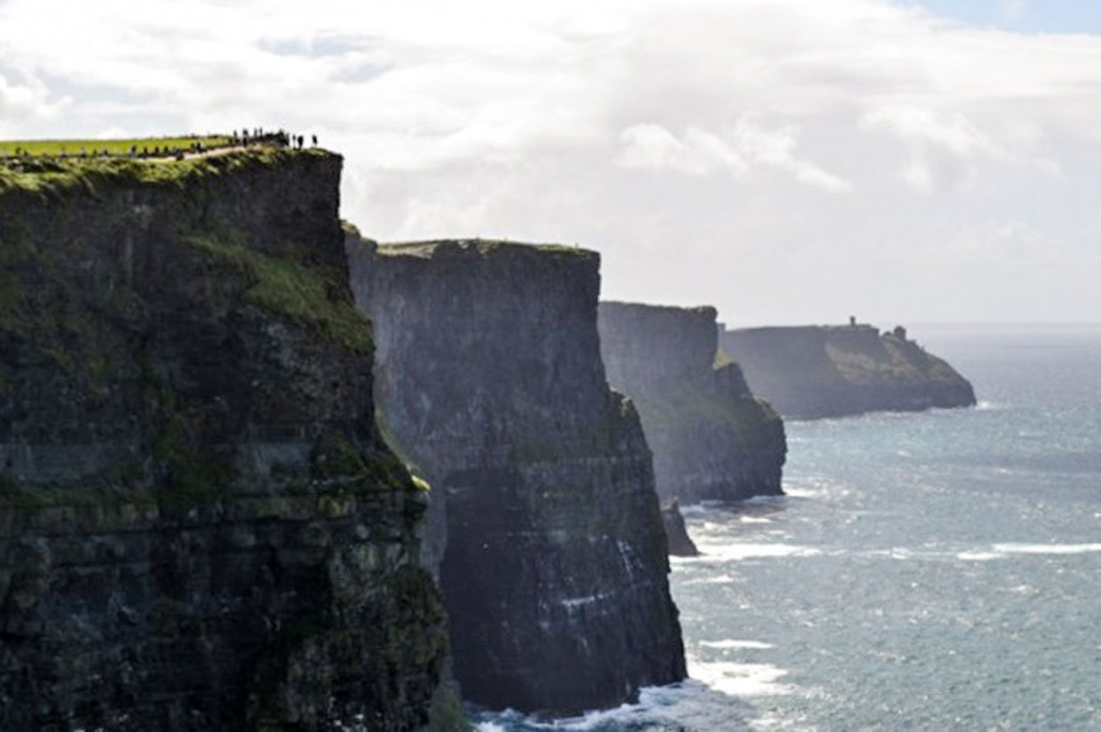 walkers on the cliffs top