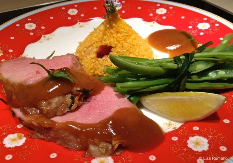 Spiced pork fillet with corn couscous and beans